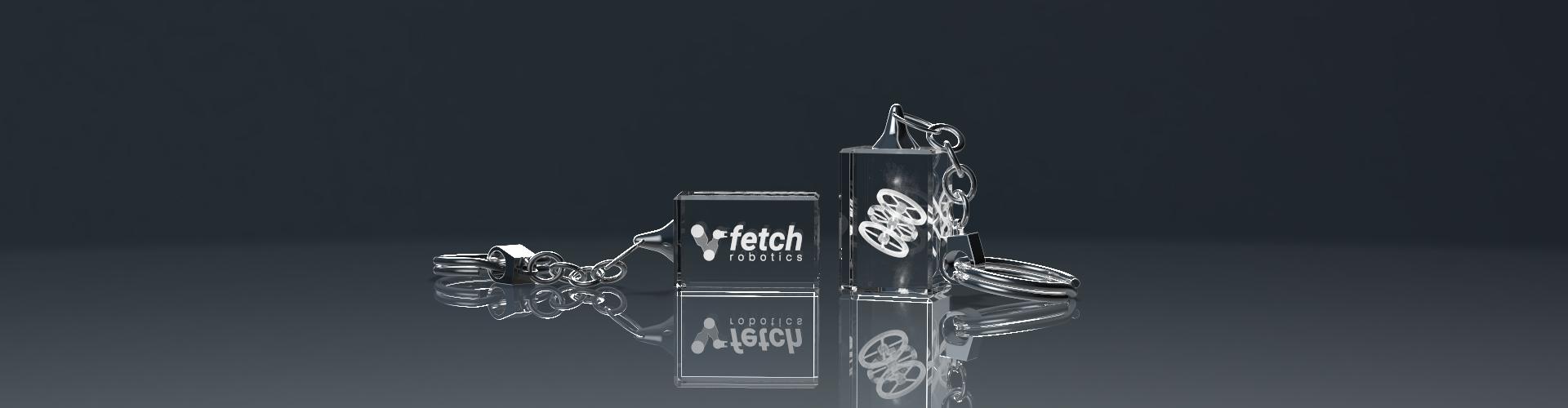 Zwei Schlüsselanhänger aus Glas mit Lasergravur